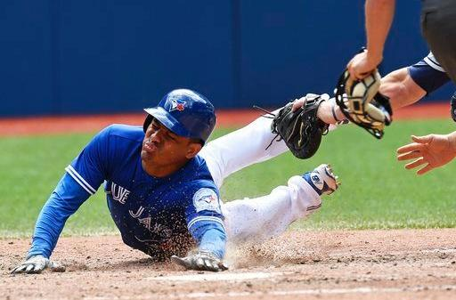 Replay Overturns Call at Plate, Spoils Streak and Davis Cycle; Blue Jays 9, Indians 6