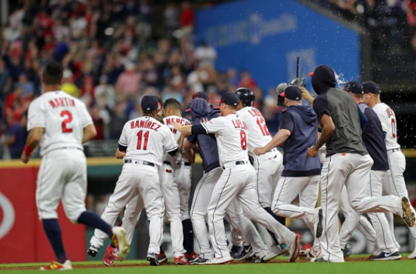 Mercado's Bases Loaded Single in Tenth Wins it for Tribe; Indians 2, Reds 1